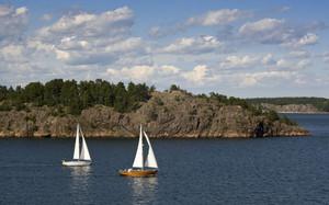 Sailboats along a rocky coast