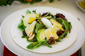 Salad With Pears, Walnuts And Cheese On White Plates