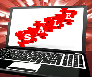 Sale Puzzle On Laptop Shows Price Discounts