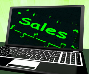 Sales On Laptop Showing Promotions