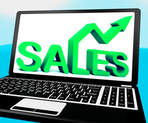 Sales On Notebook Showing Marketing Profits