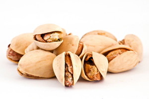 Salty Nuts Of Roasted Pistachio On Isolated Background