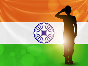 Saluting Soldier Silhouette On Indian Flag Waving Background.