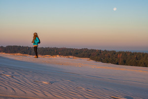 Sand dunes landscape with distant man walking. Photographed in Slowinski National Park
