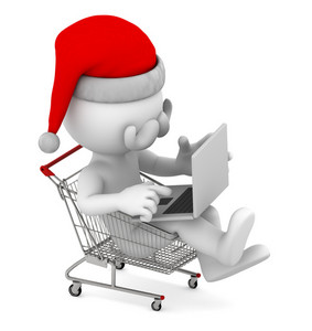 Santa With Laptop Inside Shopping Cart. E-commerce Concept.