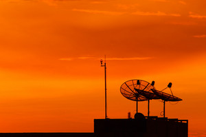 Satellite dish at sunset