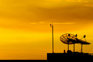 Satellite dish at sunset