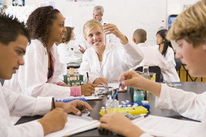 School children and their teacher in a high school science class
