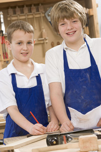 Schoolboys in woodwork class