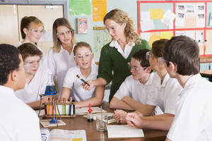 Schoolchildren and teacher in science class