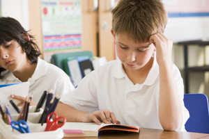 Schoolchildren reading books in class