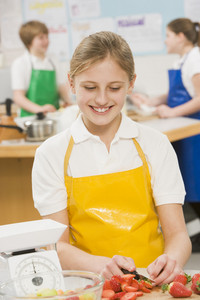 Schoolgirl at school in a cooking class