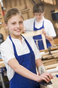 Schoolgirl in woodwork class