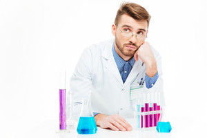 Scientist pouring chemicals isolated on a white background