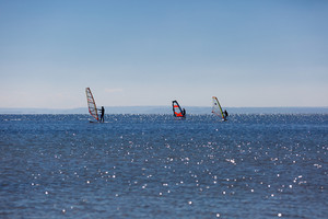 Seascape with windsurfer on swimming on sea surface. Beautiful Gdanska bay in summer