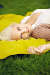 Seductive woman lying on blanket