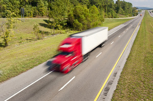 Semi Truck Speeding Down the Interstate Highway
