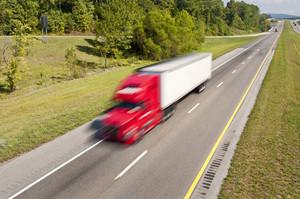 Semi Truck Speeding Down the Interstate Highway