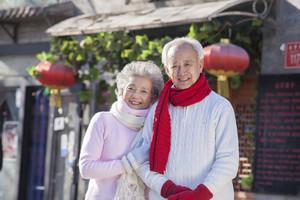 Senior couple portrait in holiday attire