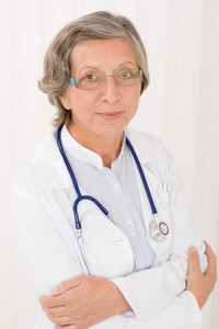 Senior doctor female in white with stethoscope professional portrait