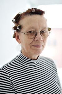 Senior lady with curlers on hair