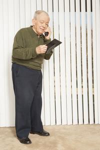 Senior man making phone call
