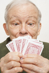 Senior man playing cards