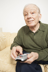 Senior man with remote control