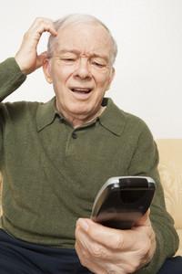 Senior man with remote control