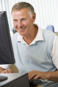 Senior man working on a computer