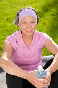 Senior sportive woman happy relax with water sunny outdoor