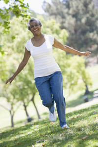 Senior woman exercising in leafy park
