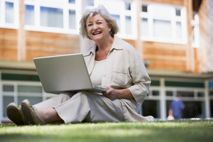 Senior woman using laptop on campus