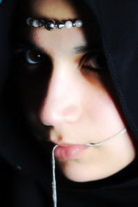 Sensual eastern, asian, arabic woman, glamure under the scarf