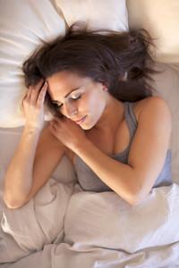 Serene woman lying on bed having a good night's sleep