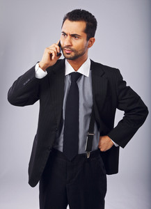 Serious businessman annoyed by a phone call