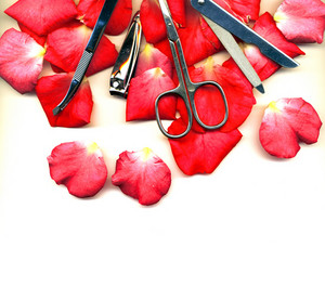 Set For Manicure On A White Background With Rose Petals