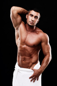 Sexy muscular sportsman over black background