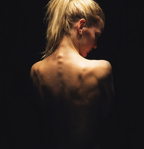 Sexy portrait of a nude woman showing her back