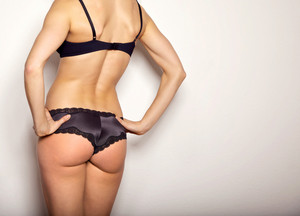 Sexy woman in her underwear showing off her back
