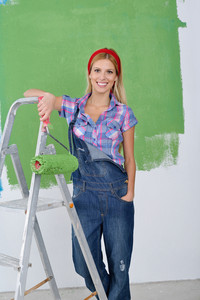 Happy Smiling Woman Painting Interior Of House