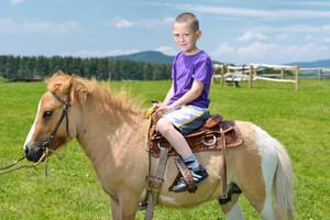 Child rides pony