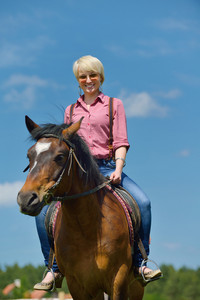 Happy woman ride horse