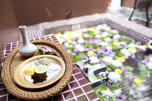 Shallow depth spa massage setting with thai herbal compress stamps