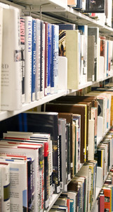 Shelves full of books in a public library.