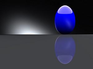 Shiny Blue Egg On Black Background.