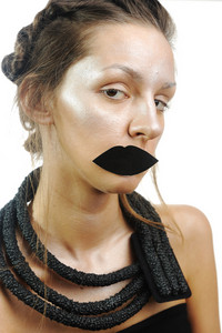 Shiny girl with fake lips, conceptual photo