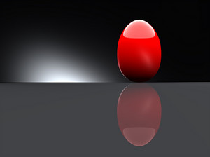 Shiny Red Egg On Black Background