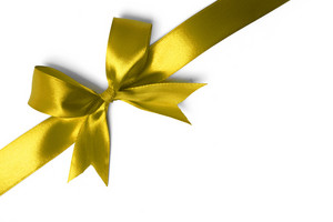 Shiny yellow satin ribbon on white background