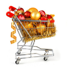 Shopping cart with christmas presents isolated on white